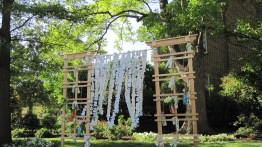 good shot of the ceremony backdrop; photo courtesy of beth cunningham
