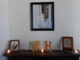 one of the mantles in the mansion, with hanna's bridal portrait, baby pic and the couple's engagement pic