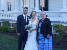 my sister karen with the bride and groom