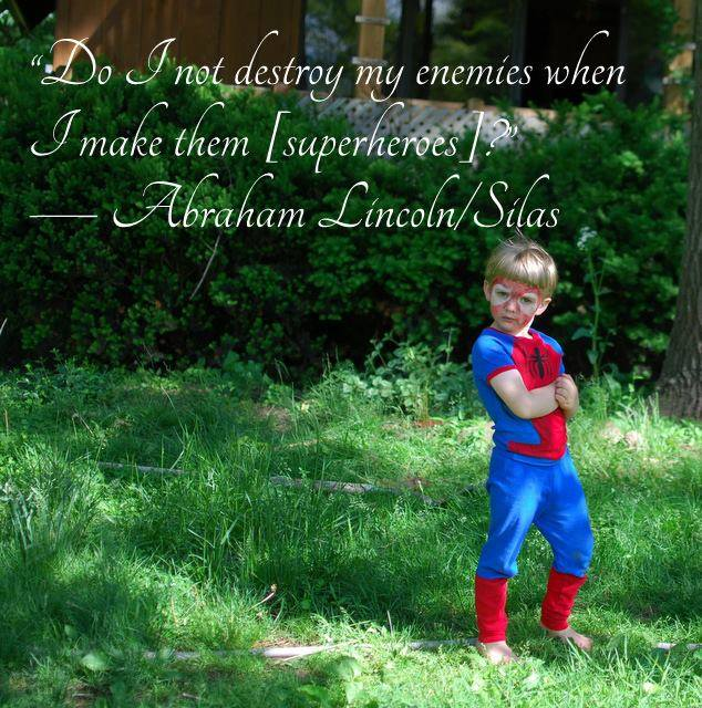 """Silas, age 4, posing as Spiderman, superimposed with the text: """"Do I not destroy my enemies when I make them [superheroes]?""""—Abraham Lincoln/Silas"""
