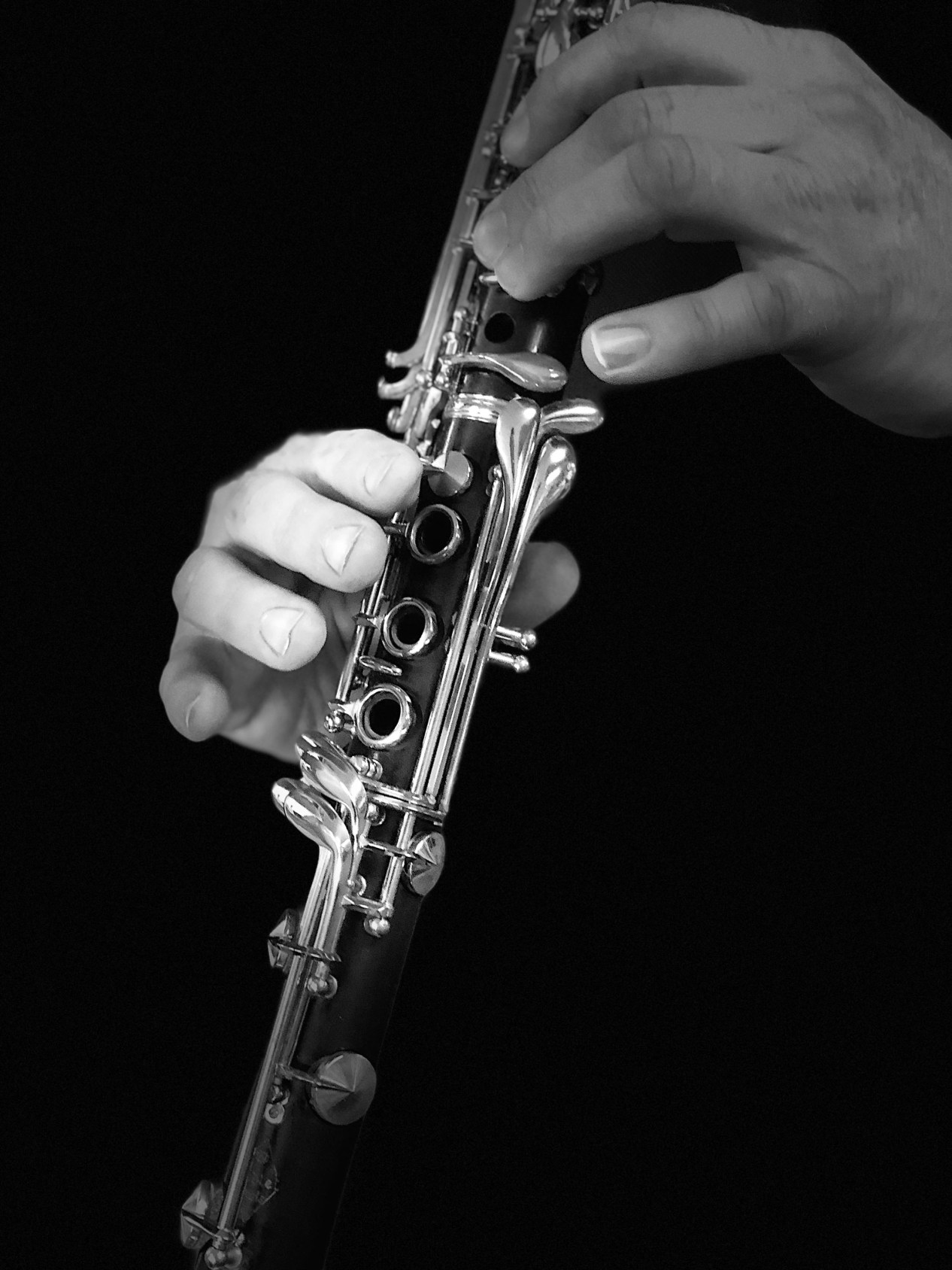 Close-up demonstration of clarinet finger positions