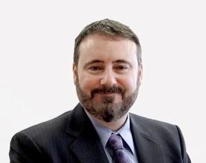 Dr. Adam Tomison