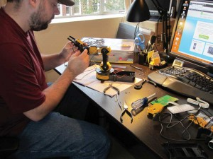 Scott is shown working on an Intel MinnowBoard demo, which was built around an OWI Robotic Arm.