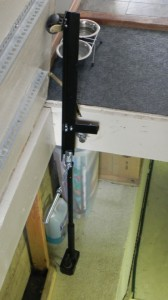 Photo 1: The screw lift and pivot arm mechanism with a spring assist are shown.