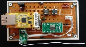 The base unit incorporates the WIZ550io, an 89LPC936 processor, a MCP79401 real-time clock, and a serial EEPROM to process reports received from the 433-MHz receiver.