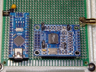 PHOTO 1 A knockoff Arduino Nano controls a generic AD9850 direct digital synthesizer circuit, both plugged into standard 0.1 inch headers, with hand-wiring connections below the proto board. The SMA connector provides a mechanically rugged output from the board; the DDS frequencies don't require its RF properties.
