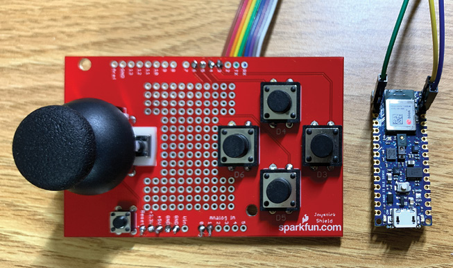 FIGURE 1 - User interface of the 2-axis gesture-controlled camera platform. The circuit board on the left is the SparkFun Joystick Shield. The 45mm × 18mm development board on the right is the Arduino Nano 33 BLE Sense.