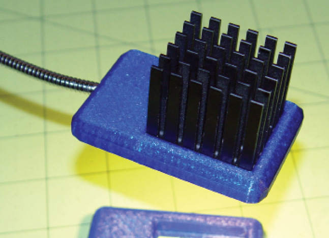 Photo 3  A recycled Northbridge heatsink keeps a 3 W chip-on-board white LED 20°C above the ambient still air with a 7°C/W thermal coefficient. Atop its original 25 W chip at 100°C, the heatsink requires forced air cooling to reach 3°C/W.