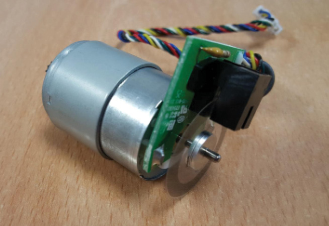 Photo 3 I settled on some brushed motors with built-in optical incremental encoders.