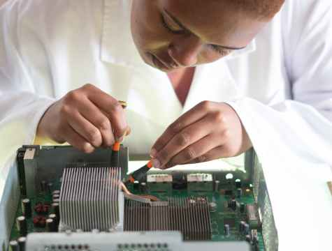 crop focused repairman fixing graphics card on computer
