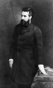 Bell as a middle aged man standing in a long coat