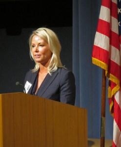 Shauna Devine speaking at a podium.