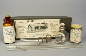 A comples set of glass tubes, capsules, glass burner and bottle.