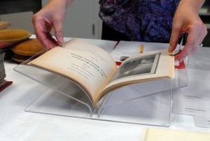 A journal resting in a custom acrylic book mount.