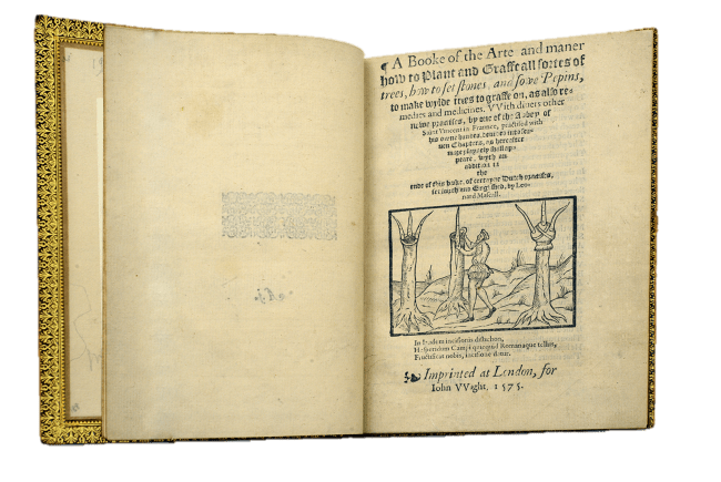 The book open to the title page including an illustration of a man and three trees in various stages of grafting.