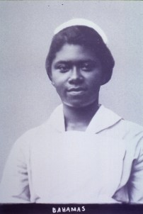 A black woman in a Nurse's uniform.
