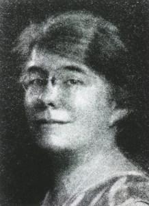 half tone portrait image of Emily Dunning Barringer in glasses.