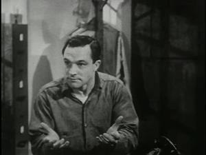 Gene Kelly as Seaman Bob Lucas, explaining.