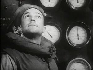 Gene Kelly as Seaman Bob Lucas wearing a life vest and sailor hat gazes upward, a panel of gauges display behind him.