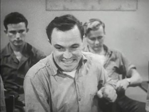 Gene Kelly as Seaman Bob Lucas expresses distress.