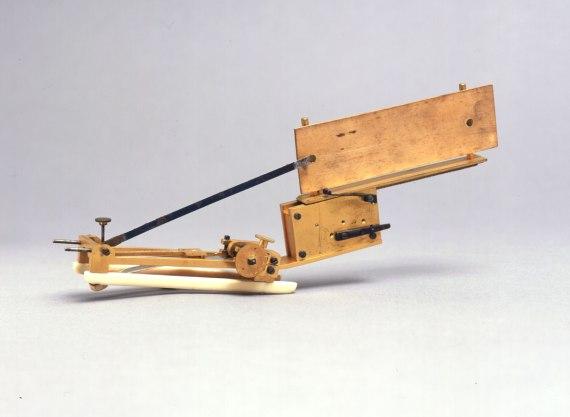 A brass and ivory clockwork instrument.