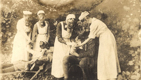 Nurses in gas masks at the trenches, Germany
