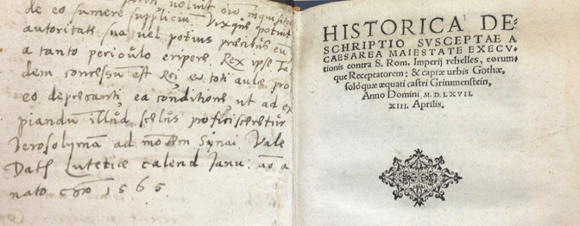 A book in Latin open to the title page showing handwritten Latin on the opposite page.