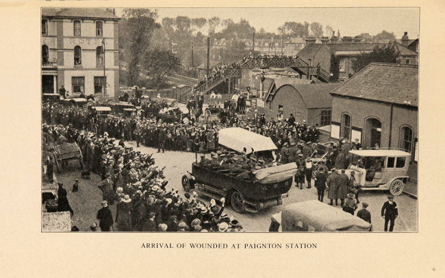 Arrival of wounded at Paignton Station, crowds cheer vehicles full of soldiers in the street.