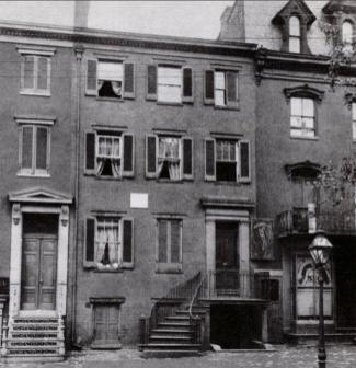 A three story brick townhouse.