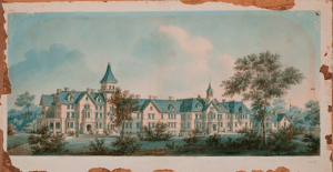 A very large, sprawling, high windowed, four story building with two steeples.