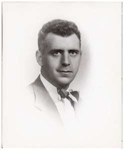 A vignette portrait of John E. Fogarty with striped bow tie.