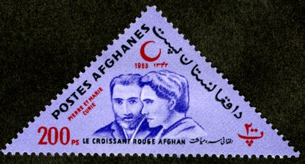 1953 triangular stamp featuring the headshots of Pierre and Marie Curie. Postes Afghanes.