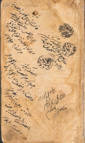Stamps and handwritten inscriptions