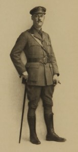 A photograph of a man with a cane in a WWI uniform.