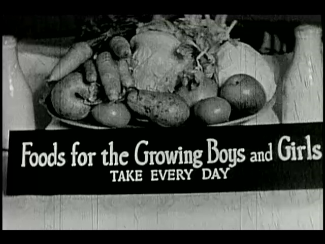 A bowl of fruit and vegetables with the text: Foods for the Growing Boys and Girls - Take Every Day