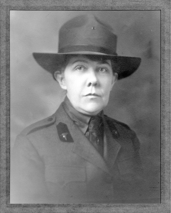 Formal portrait of a woman in a military uniform.