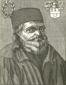 Portrait of an old man with a long beard and cap.