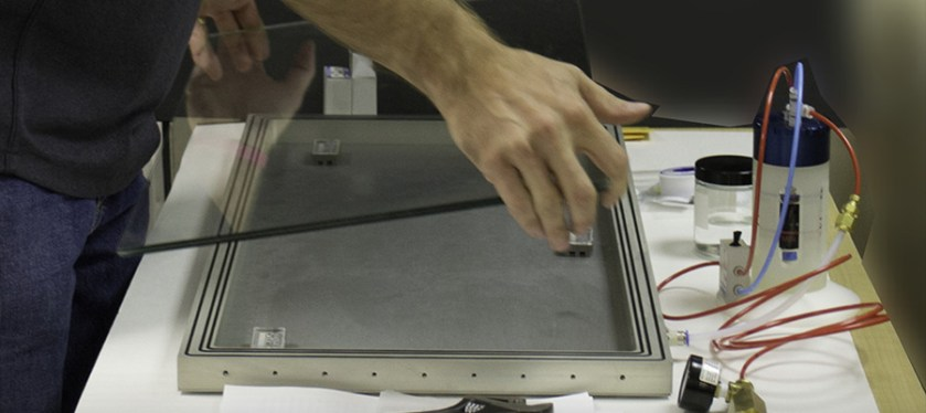 Placing the galss in a custom, airtight metal frame for a unique archival document.