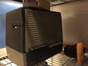 A projector in its protective case.
