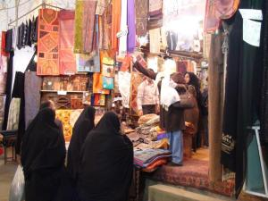 People looking at textiles in a shop.