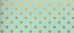 Gold stars and suns on an aqua background.