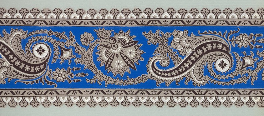 A paisley battern in grey and blue on a green background.