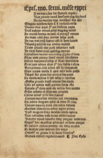 A page of printed text in gothic type Latin with a torn and repaired corner.