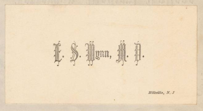 A heavy paper card with raised gothic script.