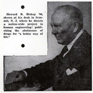 A clipping from a newspaper showing a middle aged white man in a suit sitting in profile.