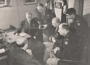 A group of white men in U.S. Army uniforms
