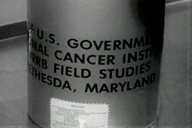 A cannister reads U.S. Government...cancer field studies...Bethesda Maryland.