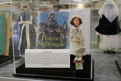 A book about Florence Nightingale, a Florence Nightingale doll, and a Florence Nightingale postage stamp