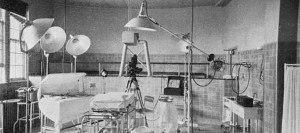Photograph of an operating room with camera and lights.