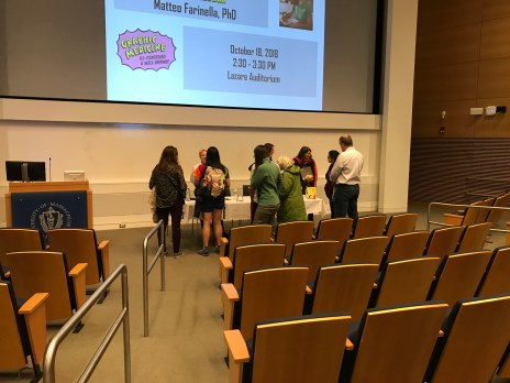 People talk after a presentation